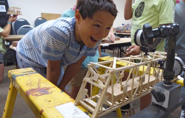 Load testing a model truss bridge